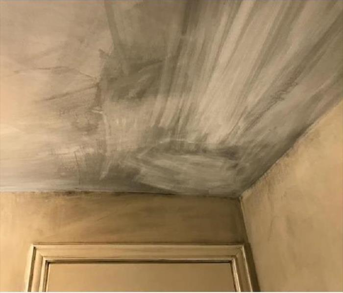 soot on ceiling above doorway